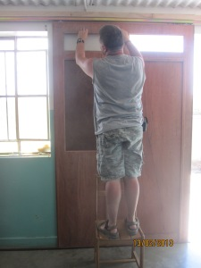 Pete working hard on our beautiful new doors